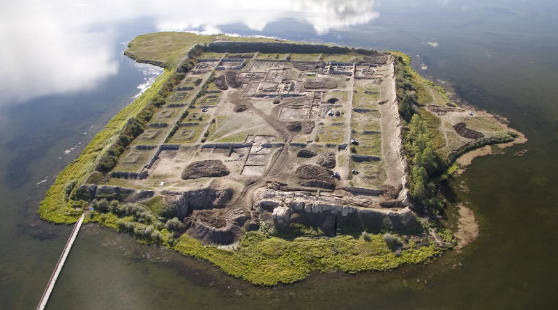 This is an aerial view of Por-Bajin from the west. The complex is situated on an island in a lake. Scientists have pinned its construction on the year 777 CE, using a special carbon-14 dating technique, based on sudden spikes in the carbon-14 concentration. CREDIT Andrei Panin