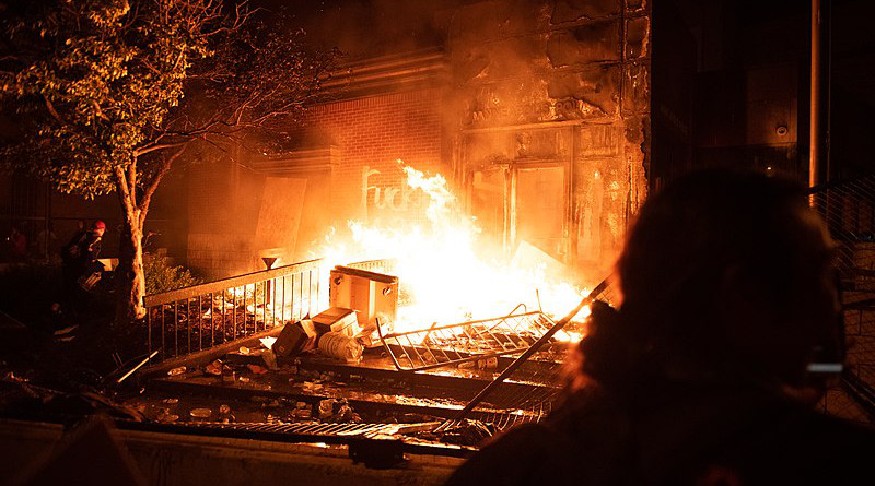 George Floyd protesters overtaking and burning the Minneapolis Police's 3rd Precinct. Photo Credit: Hungryogrephotos, Wikipedia Commons