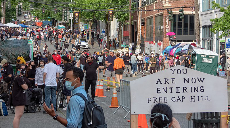 Western entrance to Seattle's Capitol Hill Autonomous Zone (CHAZ). Photo Credit: Alex Glidewell, Wikipedia Commons.