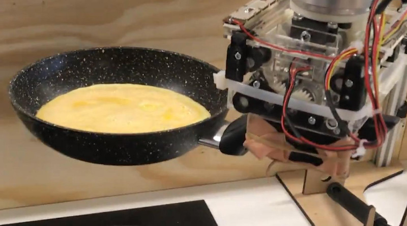 Robot arm preparing an omelette. CREDIT: University of Cambridge