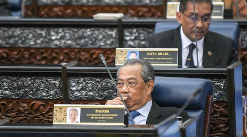 Malaysian Prime Minister Muhyiddin Yassin (front) sits in Parliament in Kuala Lumpur. Photo Credit: S. Mahfuz/BenarNews