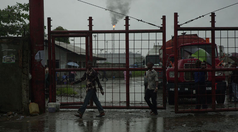 The gates of the oil refinery in Port Harcourt, Nigeria. Photo Credit: sixoone - Wish For Africa, Wikipedia Commons