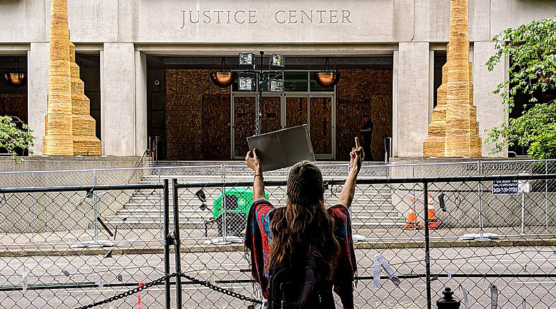 Daytime protester in front of the Multnomah County Justice Center in Portland, Oregon. Photo Credit: Ted Timmons, Wikipedia Commons