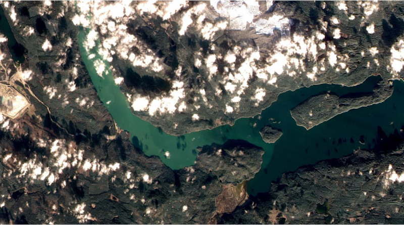 The West Basin of Quesnel Lake turned bright green in November 2014 when contaminants from the August 4, 2014 Mount Polley mine tailings spill were mixed to the surface during autumn turnover. The naturally clear blue waters of the lake are visible to the right. (Image source: FormoSat-2) CREDIT: FormoSat-2