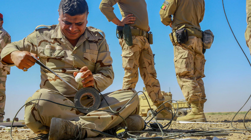 An Iraqi security forces soldier prepares an explosive device during breach training at the Besmaya Range Complex, Iraq, June 3, 2017. Photo Credit: Army Spc. William Gibson