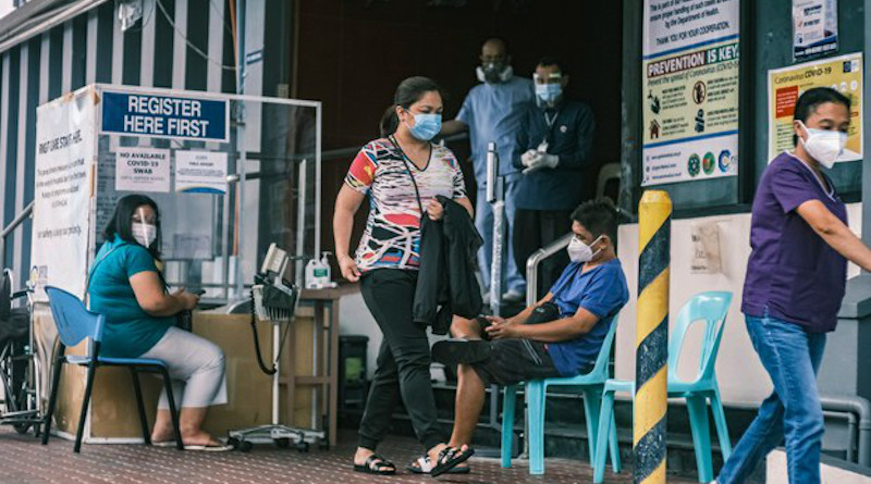 Patients outside the Capitol Medical Center in Quezon City, Philippines, are processed for COVID-19 testing. Photo Credit: Luis Liwanag/BenarNews