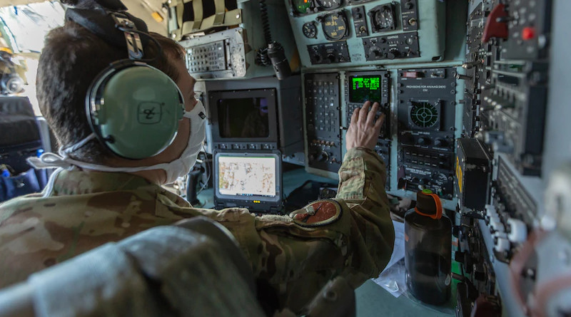 Air Force Lt. Col. Josh Linden, a C-130H Hercules navigator with the Connecticut Air National Guard's 103rd Airlift Wing, programs the flight computer before takeoff. Flight computers such as the ones in C-130H aircraft are built with microelectronics, and the Defense Department must ensure those microelectronics are safe to use before they are installed in weapons systems. Photo Credit: Marine Corps Staff Sgt. Hector de Jesus