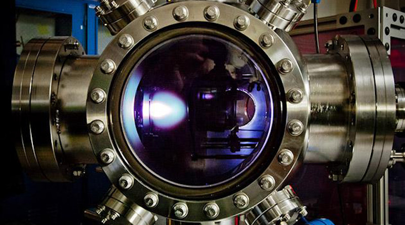 """To make the new material, the thin film is first deposited via a pulsed-laser deposition process in this chamber. The bright """"plume"""" you see is the laser hitting the target and depositing the material. CREDIT: Martin/UC Berkeley"""