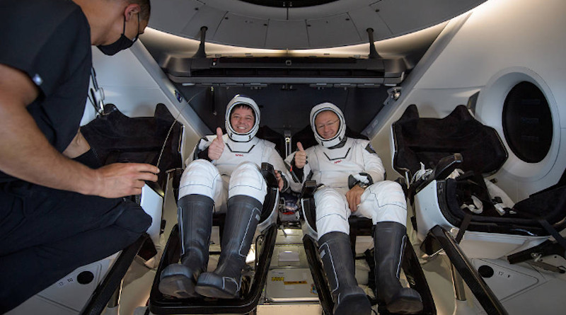 NASA astronauts Robert Behnken, left, and Douglas Hurley are seen inside the SpaceX Crew Dragon Endeavour spacecraft onboard the SpaceX GO Navigator recovery ship shortly after having landed in the Gulf of Mexico off the coast of Pensacola, Florida, Sunday, Aug. 2, 2020. The Demo-2 test flight for NASA's Commercial Crew Program was the first to deliver astronauts to the International Space Station and return them safely to Earth onboard a commercially built and operated spacecraft. Behnken and Hurley returned after spending 64 days in space. Image Credit: NASA/Bill Ingalls