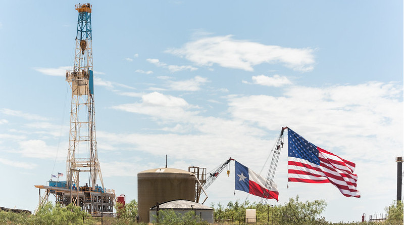 U.S. and Texas flags fly above the stage area where President Donald J. Trump delivered his remarks on restoring energy dominance in the Permian Basin prior to signing presidential permits Wednesday, July 29, 2020, at the Double Eagle Oil Rig in Midland, Texas. (Official White House Photo by Shealah Craighead)