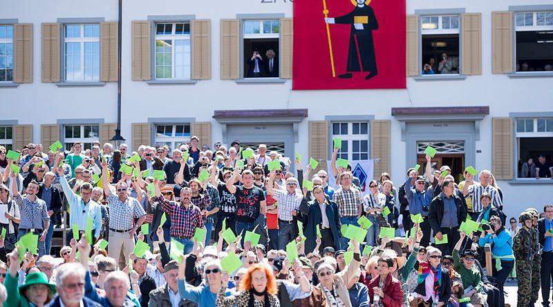 A Landsgemeinde (open-air assembly) in Glarus, Switzerland. Photo Credit: Kanton Glarus, Samuel Trümpy Photography, Wikipedia Commons