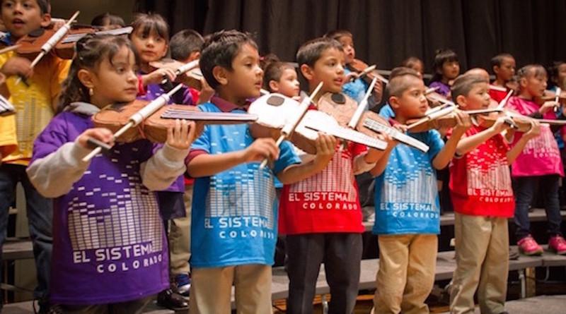 Students studying music in El Sistema program. Photo Credit: Majoring in Music