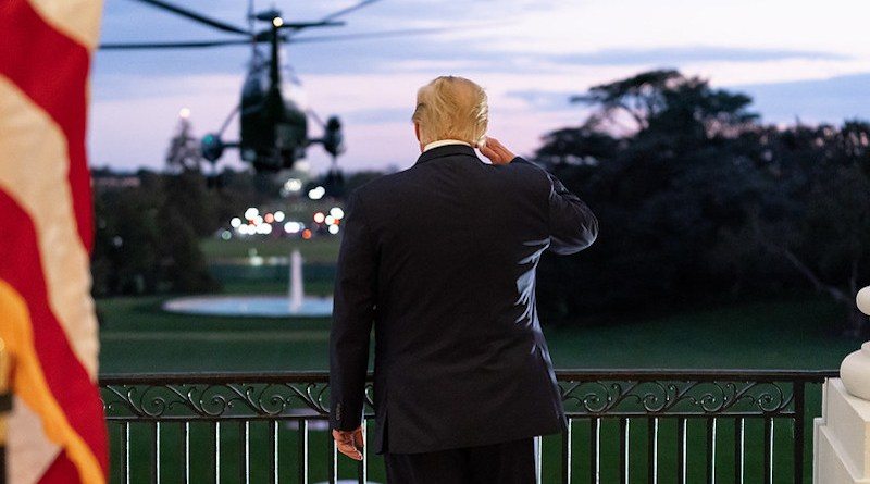 President Donald J. Trump salutes Marine One from the Blue Room Balcony of the White House. (Official White House Photo by Andrea Hanks)