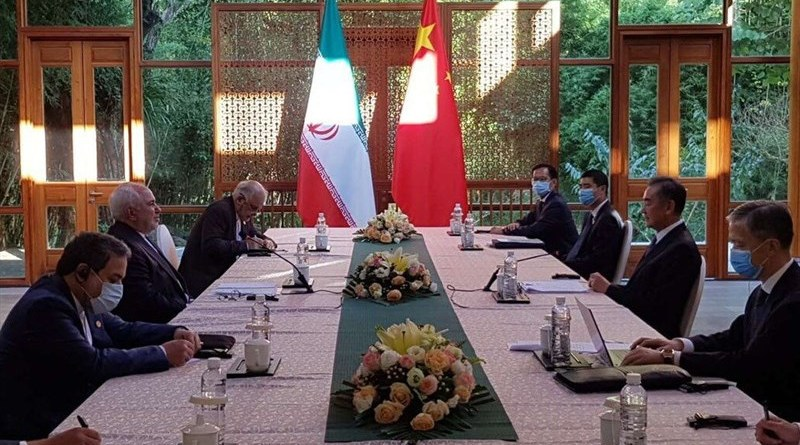 Iranian Foreign Minister Mohammad Javad Zarif meets with Chinese counterpart Wang Yi. Photo Credit: Tasnim News Agency