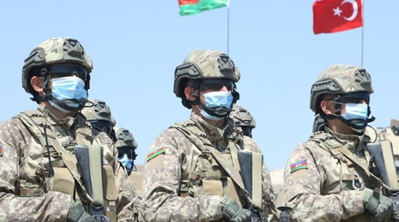 Azerbaijan soldiers with flags of Turkey and Azerbaijan in background. Photo Credit: Fars News Agency
