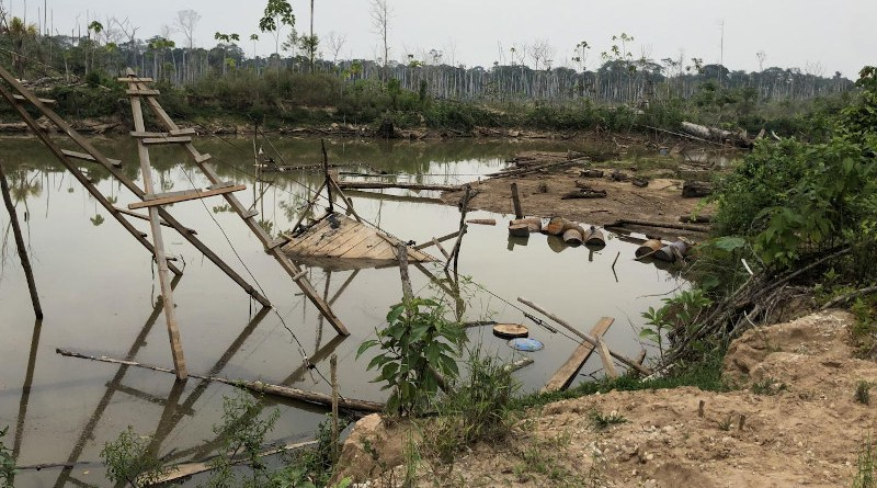 Thousands of artificial ponds like this one, created when rainwater filled in an abandoned gold mining pit, are amplifying risks of mercury exposure for humans and wildlife in the Peruvian Amazon. CREDIT: Melissa Marchese