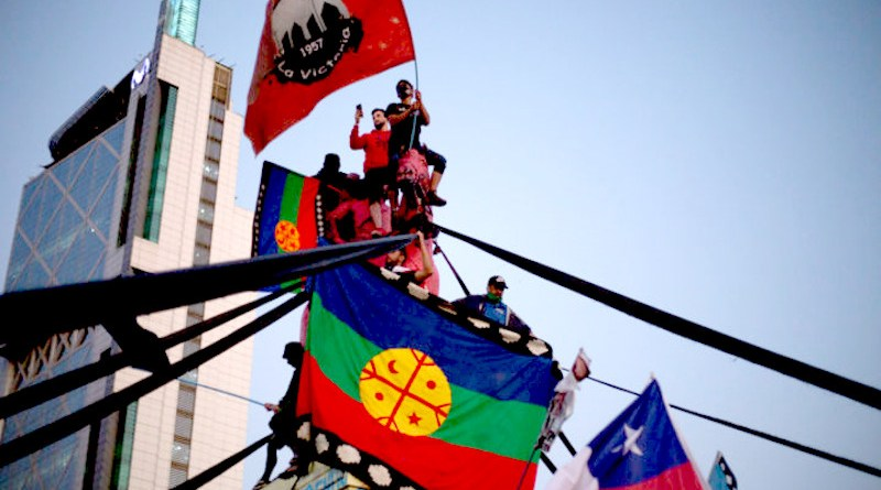 Mapuche flag, representing the original Native people of Chile and Argentina, that demand constitutional recognition, land recovery, and the end of Chilean State harassment. Photo Credit: Pressenza News Agency
