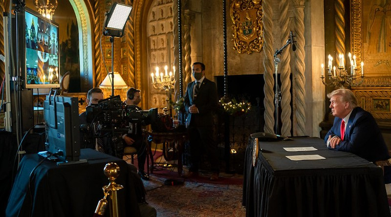 President Donald J. Trump speaks with military service personnel on duty around the world Friday, Dec. 25, 2020, during a Christmas Day video teleconference call at Mar-a-Lago in Palm Beach, Fla. (Official White House Photo by Shealah Craighead)