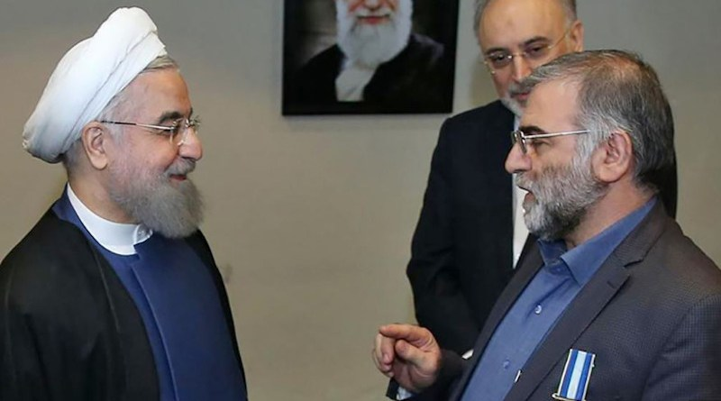 File photo shows Iranian President Hassan Rohani (left) awarding nuclear scientist Mohsen Fakhrizadeh a medal in Tehran. Photo Credit: IRNA