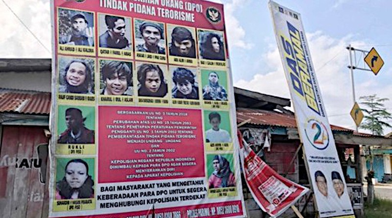 A billboard shows photographs of suspected MIT militants wanted by the authorities, in Poso regency, Indonesia, Nov. 20, 2020. [Keisyah Aprilia/BenarNews]