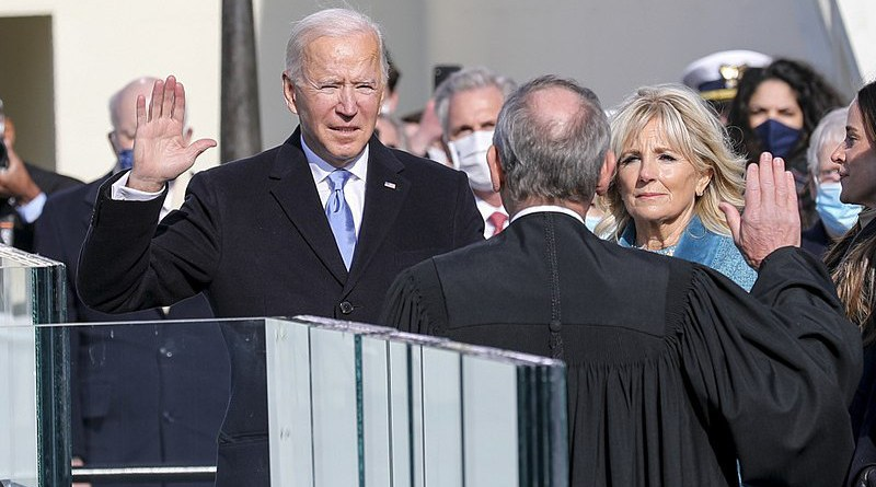 President-elect Joseph R. Biden Jr. takes the presidential oath of office at the U.S. Capitol, Washington, D.C., Jan. 20, 2021. Once the oath was completed, Biden became the 46th President of the United States of America. (DoD photo by U.S. Army Sgt. Charlotte Carulli)