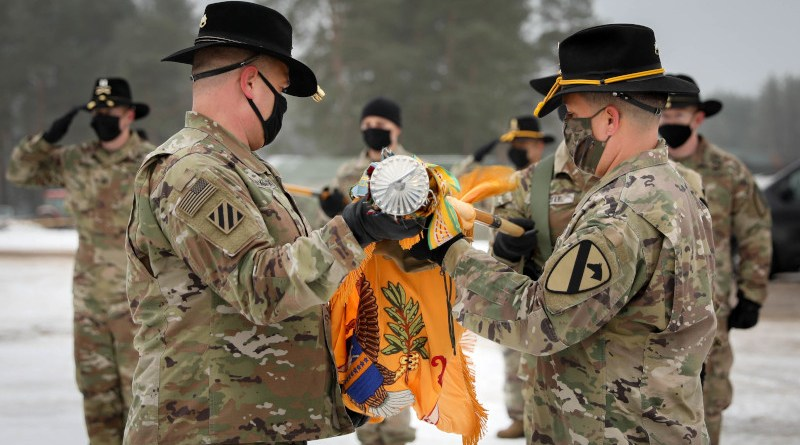 2nd Battalion, 8th Cavalry Regiment, 1st Armored Brigade Combat Team, 1st Cavalry Division Commander Lt. Col. Steven E. Jackowski and Command Sgt. Maj. Jesus Pena carefully unfurl the battalion's colors Jan. 4, 2021. The small, socially distanced ceremony officially signified the arrival of the battalion to the Pabrade Training Area, Lithuania. (Photo Credit: Sgt. Alexandra Shea)