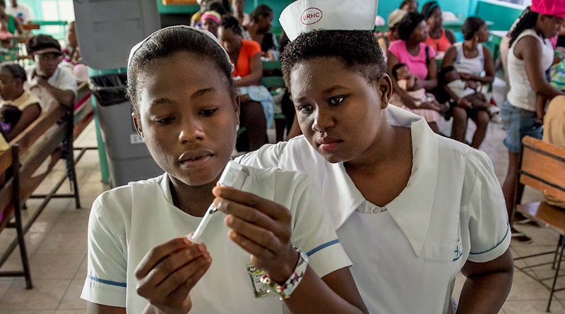 Student nurses in Haiti prepare to administer a vaccine. Open vaccine science campaigns must be delivered urgently to address hesitancy and misinformation around COVID-19 vaccines, an expert panel heard. Copyright: Karen Kasmauski, MCSP and Jhpiego, (CC BY-NC 2.0)