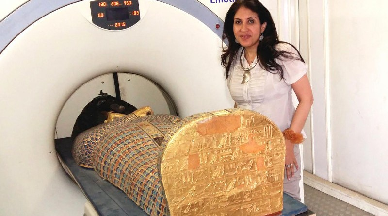 Dr Sahar Saleem placing the mummy in the CT scanner CREDIT Sahar Saleem