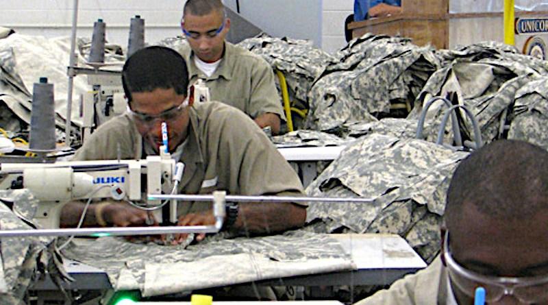 Prisoners work in a UNICOR (Federal Prison Industries) program producing uniforms. Photo Credit: Federal Bureau of Prisons