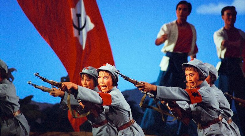 A scene from The Red Detachment of Women opera, adopted from the earlier 1961 film of the same title. Soldiers of the Women's Detachment performing rifle drill in Act II, from the 1972 National Ballet of China production. Source: Wikimedia Commons.
