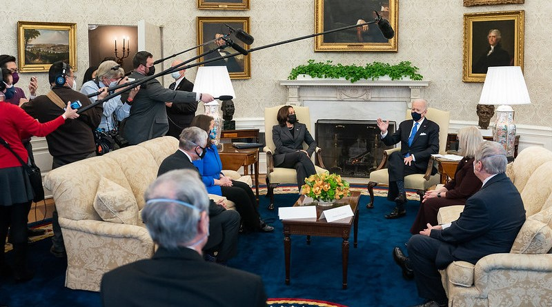 President Joe Biden, joined by Vice President Kamala Harris, talks to members of the press during a meeting with bipartisan members of Congress to discuss cancer research Wednesday, March 3, 2021, in the Oval Office of the White House. (Official White House Photo by Adam Schultz)