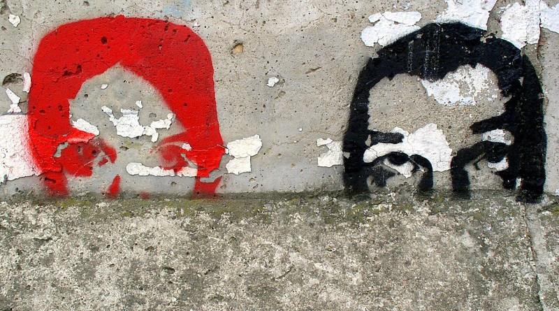 man woman couple Berlin Wall East Side Gallery Graffiti Berlin Wall