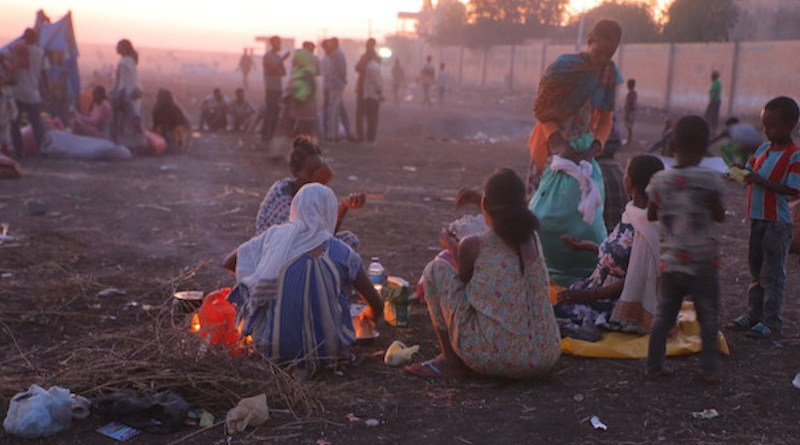 Ethiopian refugees fleeing clashes in the country's northern Tigray region, rest and cook meals near UNHCR's Hamdayet reception centre after crossing into Sudan. Credit: © UNHCR/Hazim Elhag