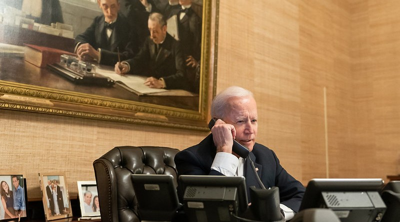 US President Joe Biden talks on the phone. (Official White House Photo by Adam Schultz)