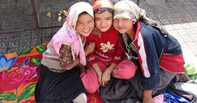 Three Uyghur girls at a Sunday market in the oasis city Khotan. Photo Credit: Colegota, Wikipedia Commons