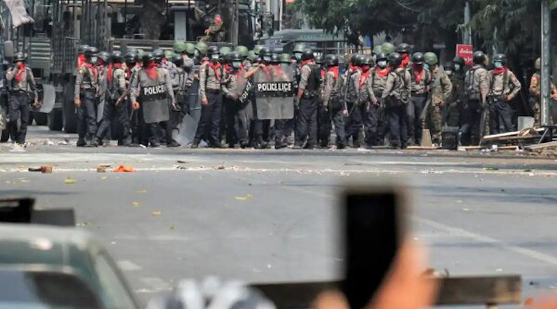 Military and police in Myanmar face off against protestors. Photo Credit: Mehr News Agency