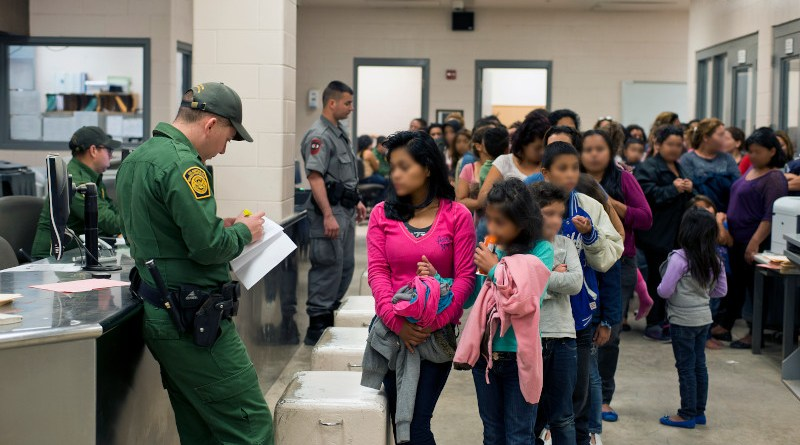File photo of U.S. Customs and Border Protection provide assistance to unaccompanied alien children after they have crossed the border into the United States. Photo provided by: Hector Silva, Wikipedia Commons