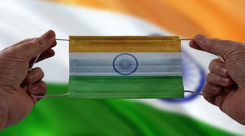 india flag hands coronavirus covid-19 mask