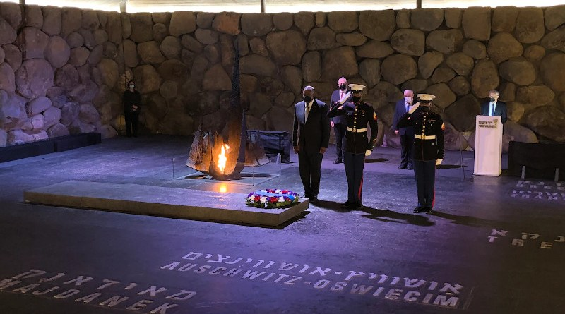 Secretary of Defense Lloyd J. Austin III stands at attention as two U.S. Marines salute after Austin placed a wreath at Yad VaShem in Jerusalem, April 12, 2021. Photo Credit: Jim Garamone, DOD