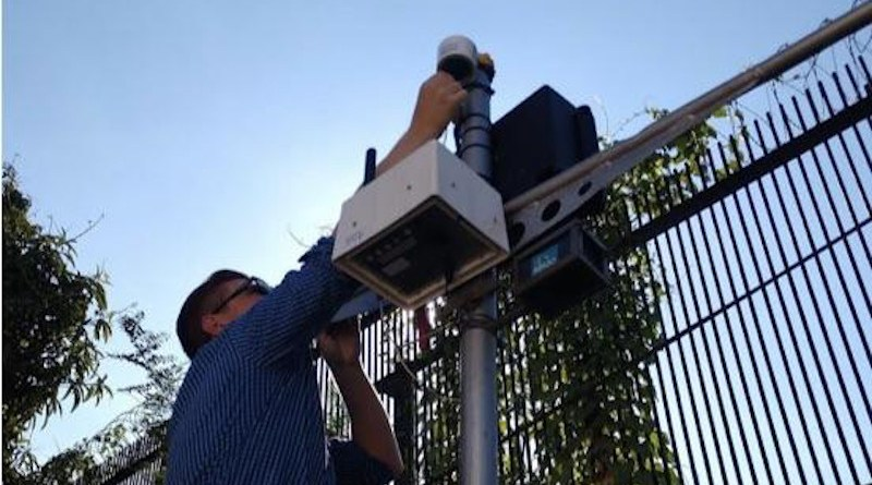 Study author Dan Westervelt sets up an air-quality monitor in Kinshasa, capital of the Democratic Republic of the Congo. CREDIT Courtesy Dan Westervelt