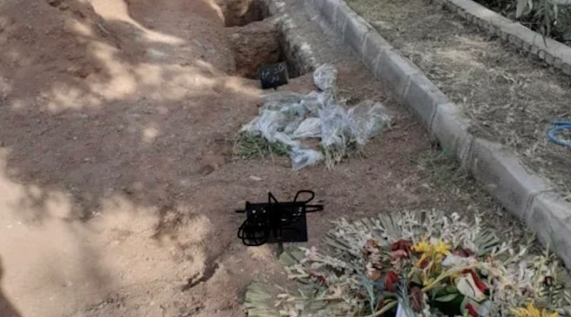Several photos such as this one of the purported new graves at Khavaran, including two that had signs and flowers laid on them, have been posted online. Credit: Social Media