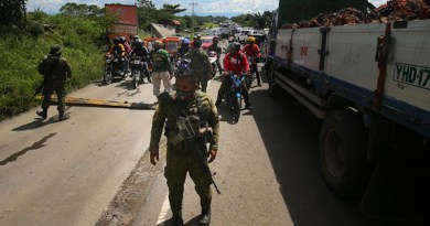Troops secure the highway outside Datu Paglas town in Maguindanao, Philippines, during an attack by members of the Bangsamoro Islamic Freedom Fighters, a group aligned with the Islamic State, May 8, 2021. Mark Navales/BenarNews
