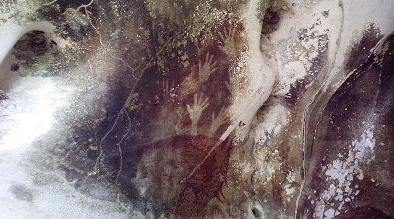 Hand prints in Pettakere Cave at Leang-Leang Prehistoric Site, Maros.. Photo Credit: Cahyo, Wikipedia Commons