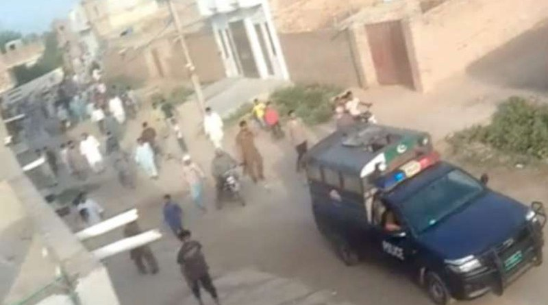 A police van patrols Chak 5 village on May 15 following a mob attack on Christian villagers. (Photo supplied)