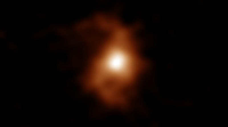 ALMA detected emissions from carbon ions in the galaxy. Spiral arms are visible on both sides of the compact, bright area in the center of the galaxy. CREDIT ALMA (ESO/NAOJ/NRAO), T. Tsukui & S. Iguchi