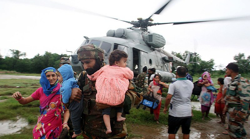 Members of India's Armed forces carry out rescue and relief during the floods in Jammu and Kashmir. Photo Credit: India Ministry of Defence, Wikipedia Commons