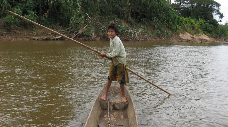 A Tsimane child in a canoe CREDIT Chapman University