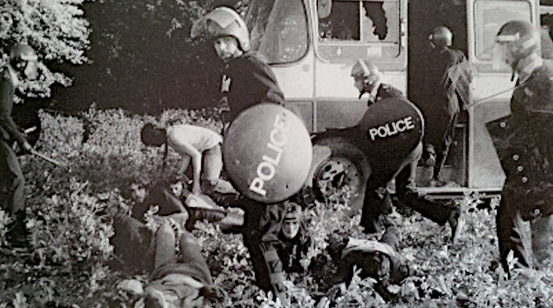 Police and Travellers at the Battle of the Beanfield. Photo Credit: Tim Malyon - Battle of the Beanfield - Andy Worthington (Enabler Publications 2005), Wikipedia Commons