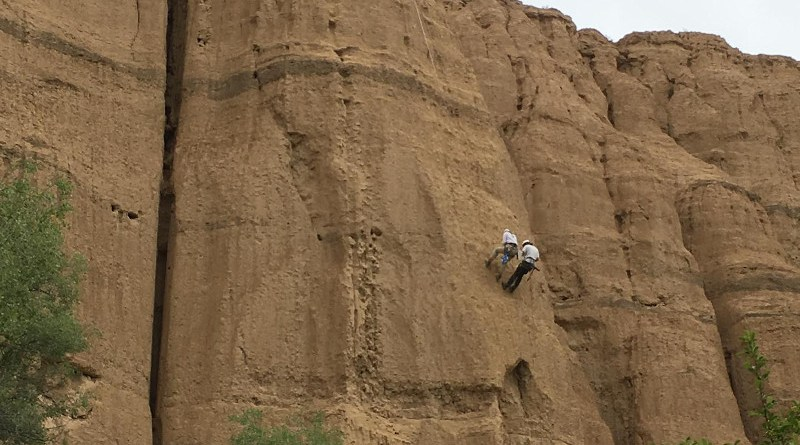 Charlotte Prud'homme is abseiling to collect soil samples. The 80-meter-thick sedimentary sequence in Charyn Canyon, Kazakhstan, documents climate change over the past 5 million years. CREDIT Charlotte Prud'homme, MPI for Chemistry