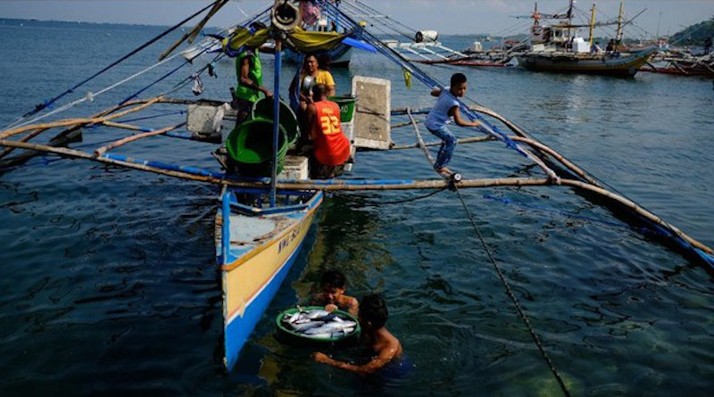 Subsistence fishermen haul a catch from their boat to shore in Infanta, a town in the northern Philippine province of Pangasinan, which faces the South China Sea. [Photo Credit: Jason Gutierrez / BenarNews]